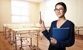 Portrait of young teacher in modern class room at school poster