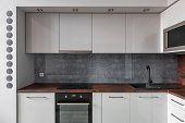 Modern Kitchen With Granite Backsplash poster