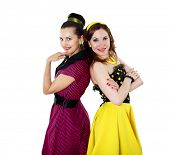 picture of poodle skirt  - two stylish young woman in bright color dresses - JPG