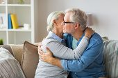 relationships, old age and people concept - happy senior couple hugging at home poster