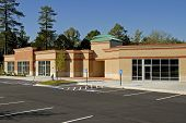stock photo of commercial building  - Newly constructed commercial building available for lease - JPG