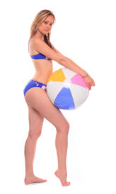 picture of beach-ball  - Attractive woman in swimsuit with ball resting on the beach - JPG