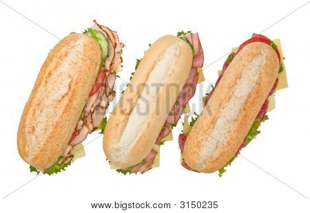 Three Submarine Sandwiches On White Background