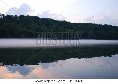 Evening Fog Forming On Lake