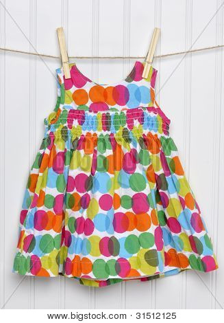Summertime Baby Girl Dress On A Clothesline.