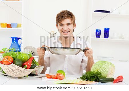 young man in kitchen