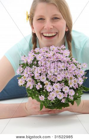 Smiling Woman With Flower Bouquet