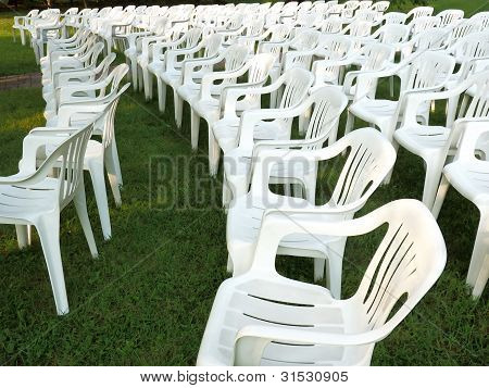 White chairs on green grass