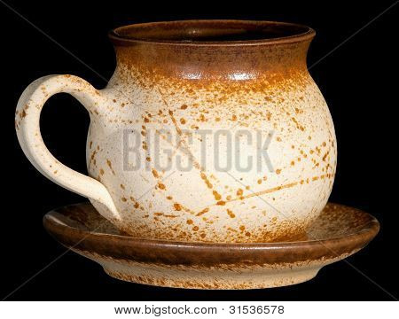 ceramic teapot with saucer isolate on black background