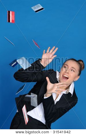 Frightened Businesswoman With Falling Bank Card