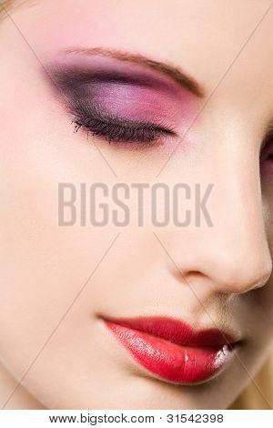 Closeup Portrait Of A Blond Beauty With Elegant Makeup.