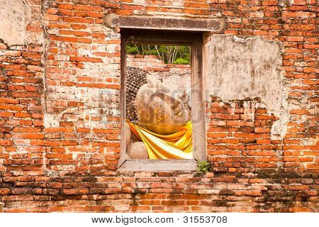 Sleeping Buddha Statue In Window