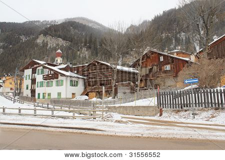 Aancient And Modern Wooden Houses In Canazei