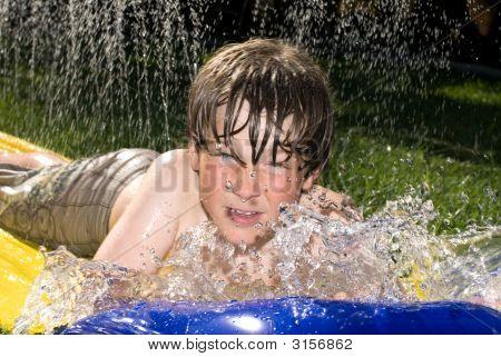 Boy On Waterslide