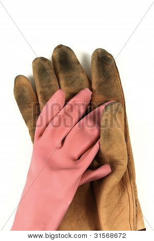 Worn Leather Work Gloves And A Pink Glove