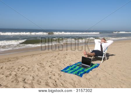 Businessman On Beach