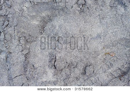 Footprint And Black Sand Texture Background