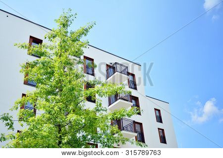 poster of Contemporary Residential Building Exterior In The Daylight. Modern Apartment Buildings On A Sunny Da