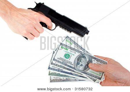 Hands with money and handgun