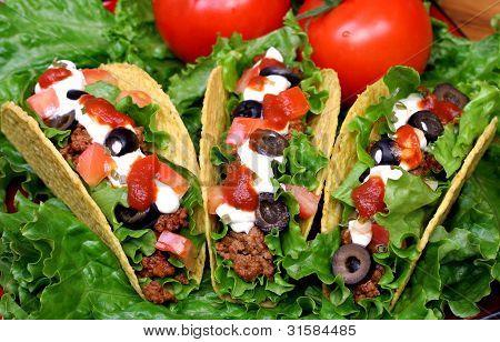 Close Up View Of Three Tacos.