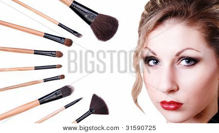 Portrait Of Beautiful Blue-eyed Girl With Makeup Brushes