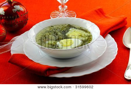 Soup With Sorrel, Potato And Egg In The White Soup Plate