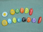 Happy Weekend Text Composed With Multi Colored Stones Over Green Sand poster