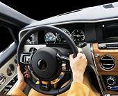 Womans Hands On The Steering Wheel Driving Modern Luxury Car. Concept Woman Driving. Hands Holding  poster