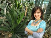 stock photo of peyote  - a photo of happy smile girl in the green Peyote Greenhouse - JPG