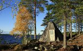 stock photo of tipi  - Autumn by a wooden tipi - JPG
