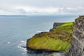 Beautiful View Of The Limestone Rock Cliffs And The Sea Along The Coastal Walk Route From Doolin To  poster