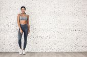 Sport Woman In Sportswear Relax Stand After Workout Against Copy Space For Adding Text With White Wa poster