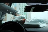 Transportation, Winter, Weather, People And Vehicle Concept - Man Cleaning Snow From Car With Scrape poster
