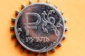 Russian Ruble Coin On An Orange Background Under The Coin Pinion Prongs Act Because Of The Coin poster