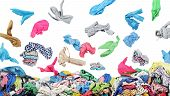 Separate Clothing Falling At The Big Pile Of Clothes On A White Background poster