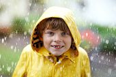 Beautiful Little Kid Boy On Way To School Walking During Sleet, Heavy Rain And Snow With An Umbrella poster