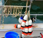 pic of lobster boat  - Bouys for marking traps on a lobster boat - JPG