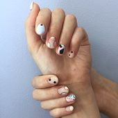 Manicure Of Different Colors On Nails. Female Manicure On The Hand On Blue Background poster