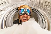 washing machine and spin. Man with aviator glasses, quick wash concept. Interior of washing machine  poster