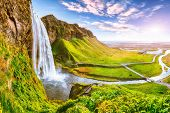 Beautiful  Seljalandsfoss Waterfall In Iceland During The Sunset. Location: Seljalandsfoss Waterfall poster