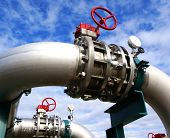 stock photo of pipeline  - Industrial zone Steel pipelines and valves against blue sky - JPG