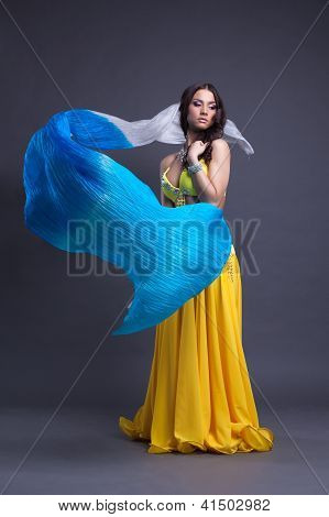Young dancer in yellow costume dance with fantail