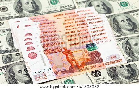 Russian Roubles Bills Laying Over Dollars Background