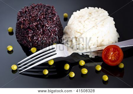Mixed Rice With Green Peas  On Black Plate