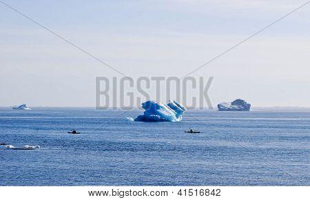 Kayakers amid Icebergs