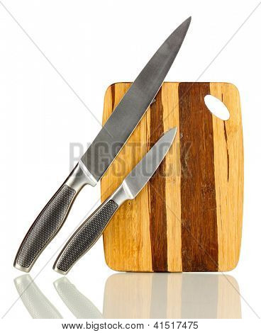 Wooden cutting board with knifes isolated on white