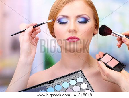 Portrait of beautiful young woman with making makeup in beauty salon