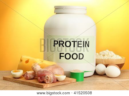 jar of protein powder and food with protein, on yellow background