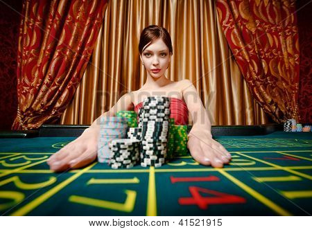 Woman wins roulette and takes away piles of chips at the gambling house