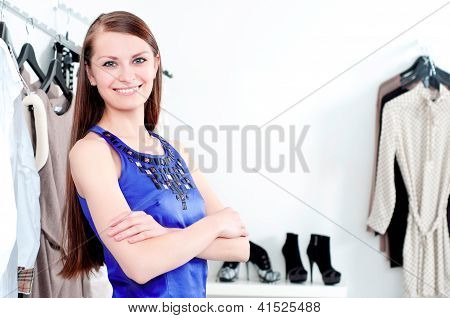 young woman in mall buying clothes